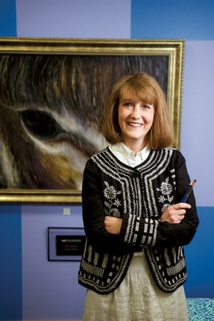 Nina Baker of Conway stands in front of a painting she did of one of her donkeys. She and her husband, Dr. David Baker, opened Art on the Green gallery about six months ago on Bob Courtway Drive in Conway. Nina, 52, has been painting since she was a child and said a doctor told her when she was about 12 that she would probably go blind, but her eyesight stabilized.
