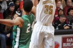 Bentonville's Malik Monk attempts a shot as Van Buren's Mitchell Smith guards during the game in Bentonville's Tiger Arena on Friday February 7, 2014.
