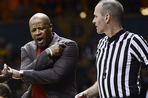 arkansas-head-coach-mike-anderson-reacts-after-an-official-called-a-foul-on-one-his-players-in-the-first-half-of-an-ncaa-college-basketball-against-vanderbilt-game-saturday-feb-8-2014-in-nashville-tenn-ap-photomark-zaleski