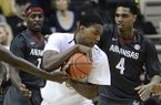Vanderbilt forward Damian Jones (30) pulls down a rebound between Arkansas guard Mardracus Wade (1) and forward Coty Clarke (4) in the first half of an NCAA college basketball game Saturday, Feb. 8, 2014, in Nashville, Tenn. (AP Photo/Mark Zaleski)