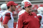 Arkansas offensive coordinator Jim Chaney, right, talks with quarterback Brandon Allen prior to a game against Rutgers on Sept. 21, 2013 at Highpoint Solutions Stadium in Piscataway, N.J.
