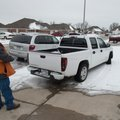 Michael Sidney, code enforcement officer, looks toward a property Friday, Feb. 7, 2014 where a truck...