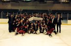 Members of Arkansas' club hockey team celebrate after winning the South Eastern Collegiate Hockey Conference championship Sunday in Pelham, Ala.
