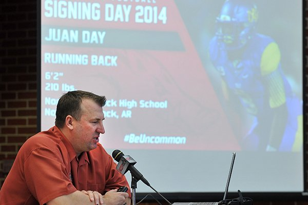 Arkansas football coach Bret Bielema talks about the Arkansas Razorbacks' new players during the national signing day press conference at the Fred Smith Center in Fayetteville.