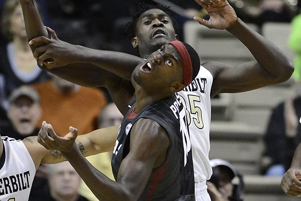 Vanderbilt forward James Siakam (35), behind, and Arkansas forward Bobby Portis, front, battle for a rebound in the first half of an NCAA college basketball game Saturday, Feb. 8, 2014, in Nashville, Tenn. (AP Photo/Mark Zaleski)