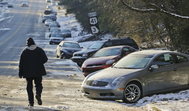 in-this-thursday-jan-30-2014-file-photo-cars-abandoned-during-an-earlier-snowstorm-sit-idle-along-northside-parkway-in-atlanta-with-memories-of-thousands-of-vehicles-gridlocked-for-hours-on-icy-metro-atlanta-highways-fresh-in-their-minds-emergency-officials-and-elected-leaders-in-north-georgia-were-preparing-monday-feb-10-2014-for-another-round-of-winter-weather