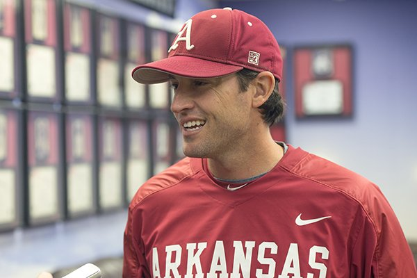 Tony Vitello, assistant coach for the Arkansas baseball team, talks with the media Friday, Feb. 7, 2014 at the University of Arkansas baseball media day at Baum Stadium in Fayetteville.