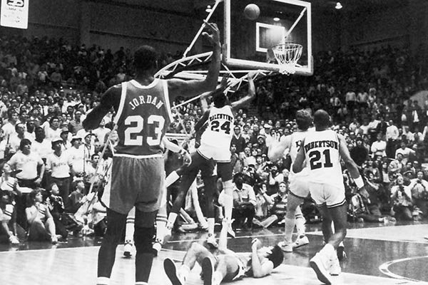 Charles Balentine (24) hits a go-ahead jumper with 4 seconds remaining as Michael Jordan (23) watches during Arkansas' 65-64 win over North Carolina on Feb. 12, 1984 in Pine Bluff.