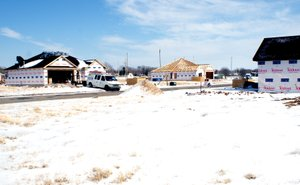 Photo by Dodie Evans Three of the four new homes under construction in Patriot Park subdivision in Gravette are pictured.