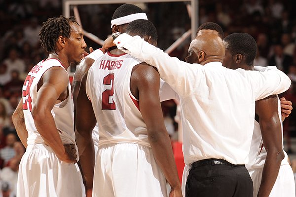 Arkansas coach Mike Anderson speaks to his team during overtime Tuesday, Jan. 14, 2014, in Bud Walton Arena in Fayetteville.