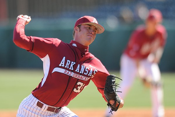 Arkansas reliever Trey Killian delivers a pitch Tuesday, March 26, 2013, during the fifth inning of play against Mississippi Valley State at Baum Stadium in Fayetteville.