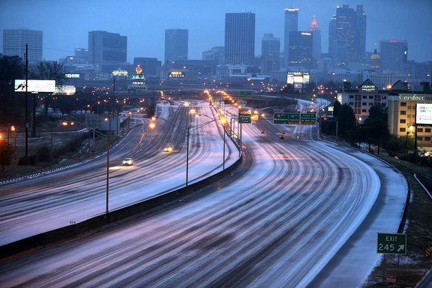 sparse-traffic-makes-its-way-on-the-interstate-7585-connector-just-south-of-downtown-atlanta-wednesday-morning-feb-12-2014-a-combination-of-sleet-snow-and-freezing-rain-was-expected-to-coat-power-lines-and-tree-branches-with-more-than-an-inch-of-ice-between-atlanta-and-augusta