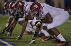 Pine Bluff running defensive end John Tate (9) during an Oct. 4, 2013 game at Hornet Stadium in Bryant.