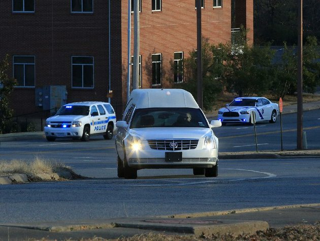 a-hearse-carrying-the-remains-of-pilot-jake-harrell-arrives-wednesday-evening-at-the-state-crime-laboratory-in-little-rock