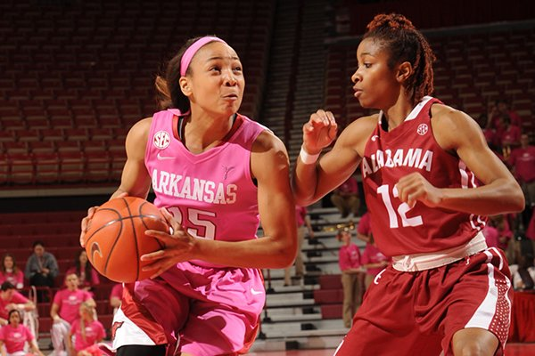 Arkansas freshman Kelsey Brooks (15) drives to the basket as Alabama senior Shafontaye Myers defends during the first half of play Thursday, Feb. 13, 2014, in Bud Walton Arena in Fayetteville.