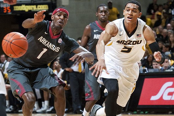 Missouri's Jordan Clarkson, right, has the ball knocked away by Arkansas' Mardracus Wade, left, during the first half of an NCAA college basketball game Thursday, Feb. 13, 2014, in Columbia, Mo. (AP Photo/L.G. Patterson)