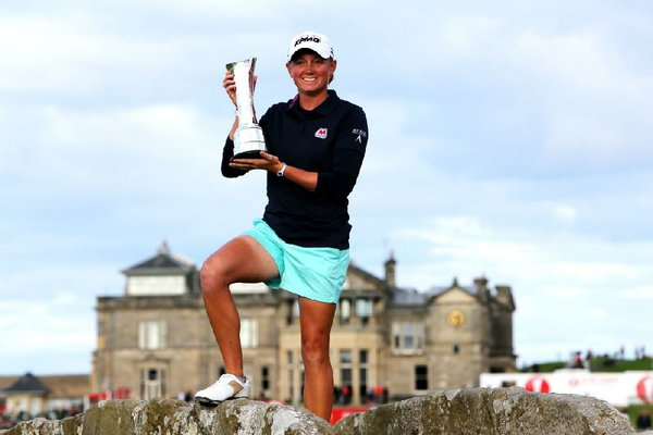 Stacy Lewis of the US poses with the trophy after winning Women's British Open golf championship on the Old Course at St Andrews, Scotland, Sunday Aug. 4, 2013. (AP Photo/Scott Heppell)