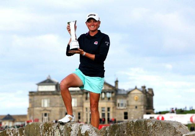 stacy-lewis-of-the-us-poses-with-the-trophy-after-winning-womens-british-open-golf-championship-on-the-old-course-at-st-andrews-scotland-sunday-aug-4-2013-ap-photoscott-heppell