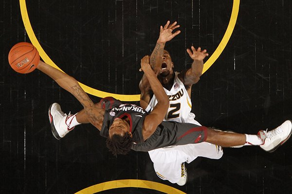 Arkansas guard Michael Qualls, bottom, collides with Missouri forward Tony Criswell during the first half of an NCAA college basketball game Thursday, Feb. 13, 2014, in Columbia, Mo. (AP Photo/St. Louis Post-Dispatch, Chris Lee)
