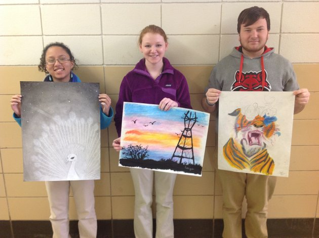 several-members-of-the-newport-high-school-art-club-will-participate-in-the-delta-visual-arts-show-on-saturday-among-those-attending-were-from-the-left-regan-williams-with-her-artwork-midnight-katie-lewis-with-the-sunset-and-chris-heisler-with-psychedelic-tiger-brian-hickey-is-the-art-teacher-at-the-high-school-as-well-as-the-sponsor-of-the-art-club-he-also-will-participate-in-the-show-and-present-a-workshop-for-children-4-to-8