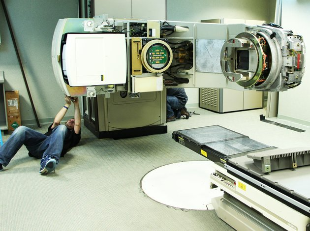 members-of-the-varian-crew-disassemble-the-former-linear-accelerator-at-the-white-river-medical-center-cancer-care-center-in-batesville-to-prepare-for-the-installation-of-the-varian-truebeam-accelerator-installation-is-expected-to-be-complete-in-four-to-six-weeks