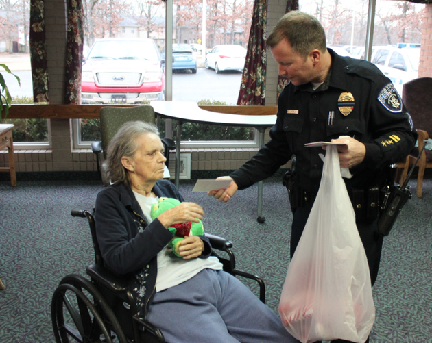 north-little-rock-police-sgt-brian-dedrick-hands-out-a-valentines-day-stuffed-toy-and-card-friday-at-northridge-healthcare-and-rehabilitation-friday