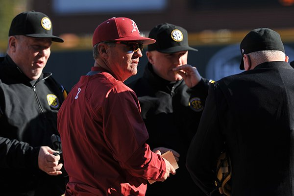 Arkansas baseball coach Dave Van Horn talks with the umpires before the start of the is season opener against Appalachian State Friday afternoon at Baum Stadium in Fayetteville.
