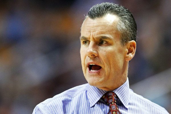 Florida head coach Billy Donovan yells to his player's in the second half of an NCAA college basketball game against Tennessee on Tuesday, Feb. 11, 2014, in Knoxville, Tenn. (AP Photo/Wade Payne)