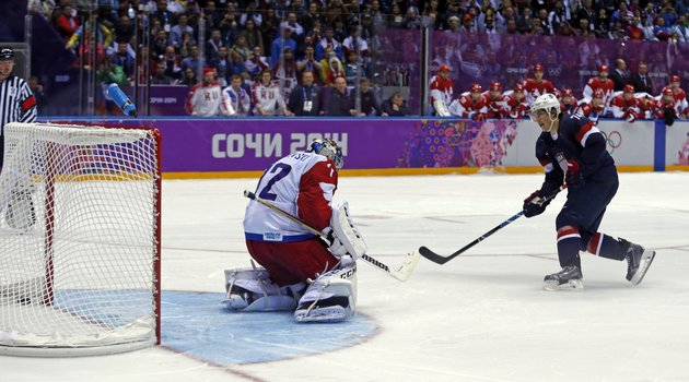 usa-forward-tj-oshie-scores-the-winning-goal-against-russia-goaltender-sergei-bobrovski-in-a-shootout-during-overtime-of-a-mens-ice-hockey-game-at-the-2014-winter-olympics-saturday-in-sochi-russia