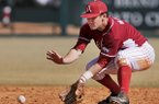Arkansas shortstop Brett McAfee fields a ground ball during game two of the series against Appalachian State on Saturday February 15, 2014 at Baum Stadium in Fayetteville.