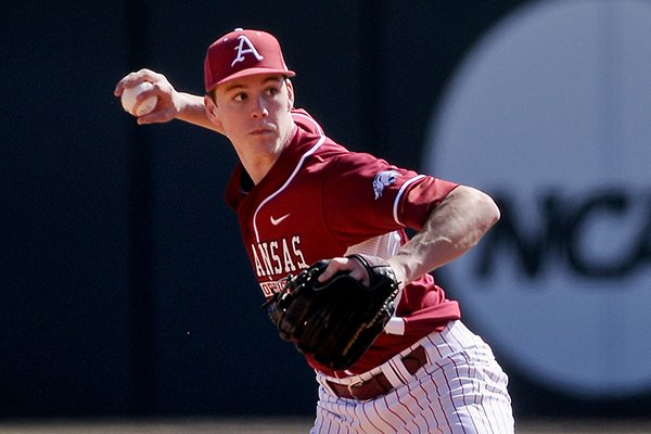 Arkansas second baseman Brian Anderson throws to first during game two of the series against Appalachian State on Saturday, Feb. 15, 2014 at Baum Stadium in Fayetteville.