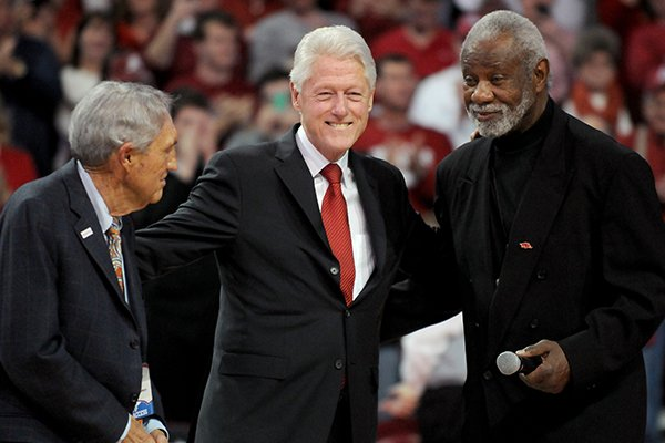 Eddie Sutton, President Bill Clinton and Nolan Richardson take part in a half-time ceremony in the game between Arkansas and LSU on Saturday February 15, 2014 in Bud Walton Arena in Fayetteville.