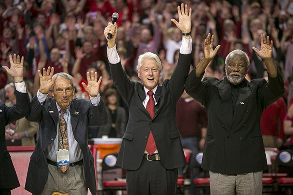 eddie-sutton-left-former-president-bill-clinton-center-and-nolan-richardson-right-call-the-hogs-during-halftime-of-an-ncaa-college-basketball-game-between-arkansas-and-lsu-on-saturday-feb-15-2014-in-fayetteville-ark-ap-photogareth-patterson
