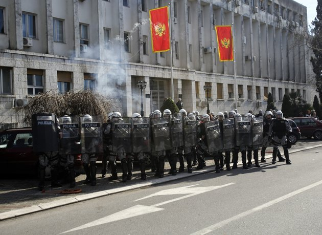 montenegro-police-officers-guard-a-government-building-during-a-protest-in-podgorica-montenegro-saturday-the-demonstrators-who-assembled-in-the-downtown-area-of-the-capital-podgorica-on-saturday-demanded-the-resignation-of-the-government-of-the-long-standing-prime-minister-milo-djukanovic-they-accuse-his-government-of-rampant-corruption-unemployment-and-economic-mismanagement