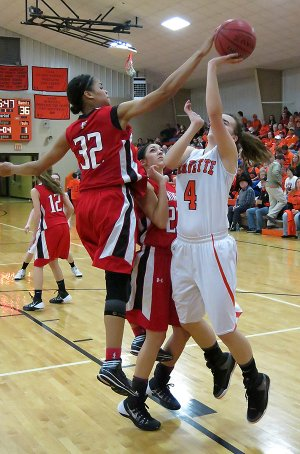 Staff Photo Randy Moll Tahlon Hopkins, Farmington junior forward, blocks a shot Jan. 31 by Gravette's Maddie Foster. Gravette will open play in the 4A-1 District Tournament at 4 p.m. today against Gentry. The District Tournament is being played in Farmington. The host Lady Cardinals will not play until 4 p.m. Friday.