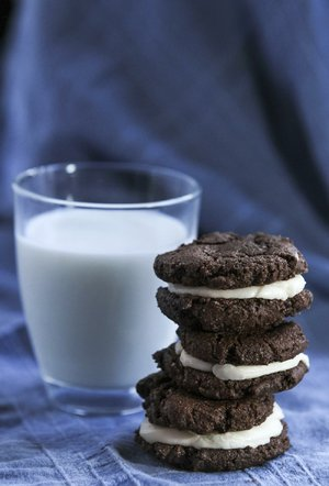Chocolate Sandwich Cookies can be thin and crunchy or puffy and soft, depending on the type of cocoa powder. Natural cocoa will create soft, puffy cookies like these.