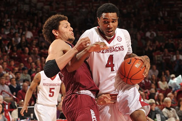 Arkansas forward Coty Clarke tries to drive past South Carolina defender Michael Carrera in the second half of Wednesday's game at Bud Walton Arena in Fayetteville.