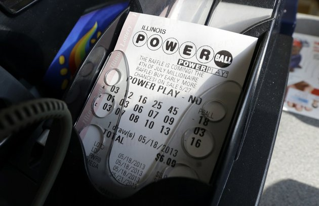 a-powerball-lottery-ticket-is-printed-out-of-a-lottery-machine-at-a-convenience-store-in-chicago-on-in-this-may-18-2013-file-photo-according-to-lottery-officials-there-were-no-jackpot-winner-for-saturday-feb-15-2014-drawing-the-current-estimated-jackpot-for-wednesdays-drawings-jackpot-is-estimated-at-400-million-or-2278-million-in-cash-value