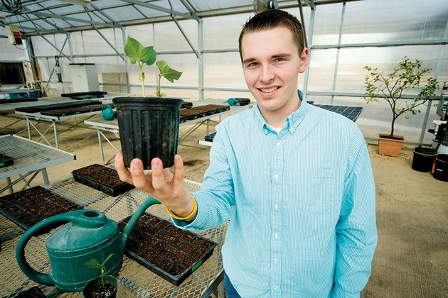 sam-harris-holds-a-plant-in-the-agriculture-department-at-greenbrier-high-school-sam-17-was-named-a-distinguished-finalist-in-the-prudential-spirit-of-community-awards-a-national-competition-for-a-program-to-help-alleviate-hunger-by-teaching-people-how-to-grow-container-gardens-he-received-a-2500-food-for-all-grant-through-the-national-ffa-to-fund-the-program
