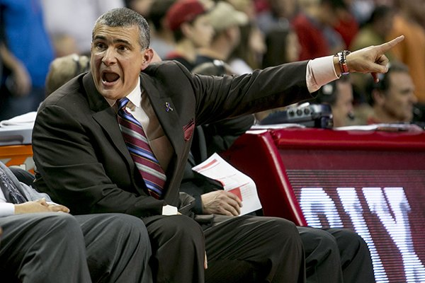 South Carolina head coach Frank Martin yells at his bench during the second half of an NCAA college basketball game against Arkansas, Wednesday, Feb. 19, 2014, in Fayetteville, Ark. (AP Photo/Gareth Patterson)