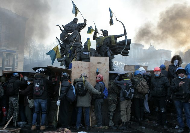 anti-government-protesters-protected-themselves-with-shields-during-clashes-with-riot-police-in-kievs-independence-square-the-epicenter-of-the-countrys-current-unrest-in-kiev-ukraine-on-wednesday-feb-19-2014