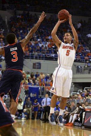 Florida's Scottie Wilbekin (right) shoots a three-pointer as Auburn's Chris Denson defends during the No. 2 Gators' victory Wednesday night in Gainesville, Fla.