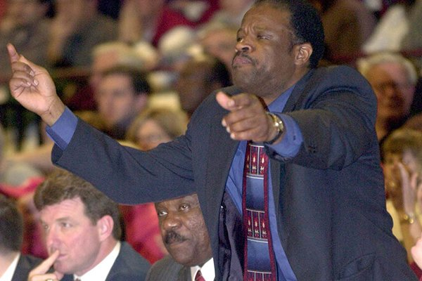 Arkansas' assistant coach Mike Anderson calls a play to the team as head coach Nolan Richardson sits on the bench during the second half of their loss to Mississippi State on Wednesday, Feb. 27, 2002 in Starkville, Miss.