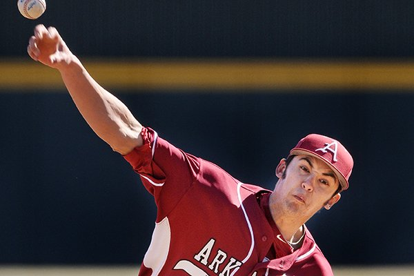 Arkansas pitcher Chris Oliver delivers the ball during game two of the series against Appalachian State on Saturday Feb. 15, 2014 at Baum Stadium in Fayetteville.