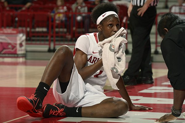 Arkansas senior Keira Peak puts a towel to her bloody lip in the first half against Vanderbilt Thursday, Feb. 20, 2014 at Bud Walton Arena in Fayetteville. Peak fell to the court while driving to the basket scoring and getting the foul.
