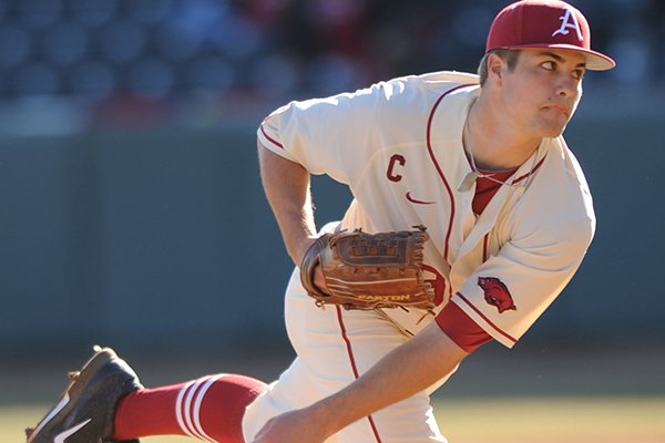 Arkansas junior starter Jalen Beeks delivers a pitch against Eastern Illinois during the second inning Friday, Feb. 21, 2014, at Baum Stadium in Fayetteville.