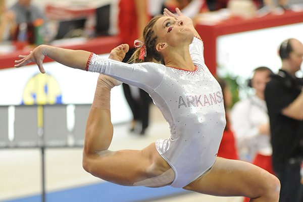 Arkansas' Katherine Grable competes in the beam during a meet with Kentucky Friday, Feb. 21, 2014, at Barnhill Arena in Fayetteville.
