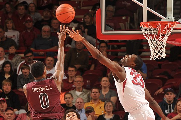 Arkansas defender Moses Kingsley tries to block the shot of South Carolina'a Sindarius Thornwell in the second half of Wednesday's game at Bud Walton Arena in Fayetteville.