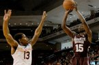 Auburn point guard Tahj Shamsid-Deen (13) defends as Mississippi State guard I.J. Ready (15) shoots during an NCAA college basketball game Saturday, Feb. 15, 2014, at Auburn Arena in Auburn, Ala. (AP Photo/AL.com, Julie Bennett)