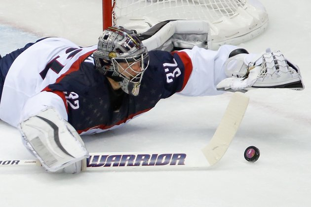usa-goaltender-jonathan-quick-dives-for-the-puck-during-the-second-period-of-the-mens-semifinal-ice-hockey-game-at-the-2014-winter-olympics-on-friday-in-sochi-russia
